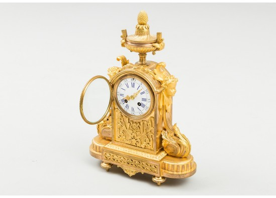 Clock and two candlesticks