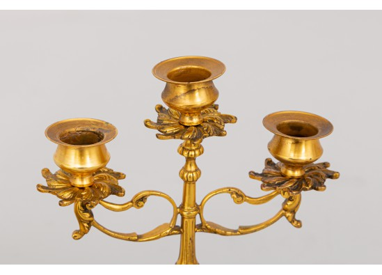 Clock with candlesticks