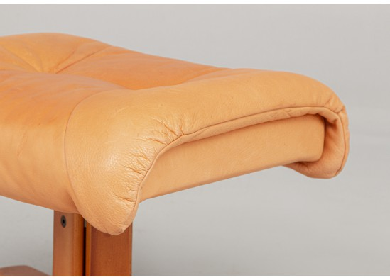 Armchair with pouf